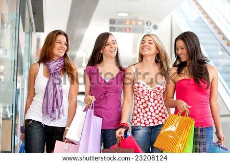group of friends shopping in a mall - stock photo