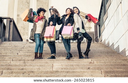 group of friends shopping together. concept about consumerism, shopping, mixed race, friendship and people - stock photo