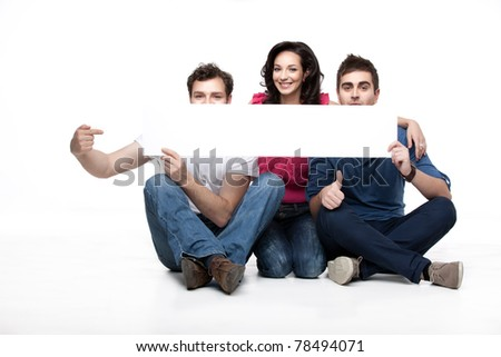 group of friends showing blank banner - stock photo