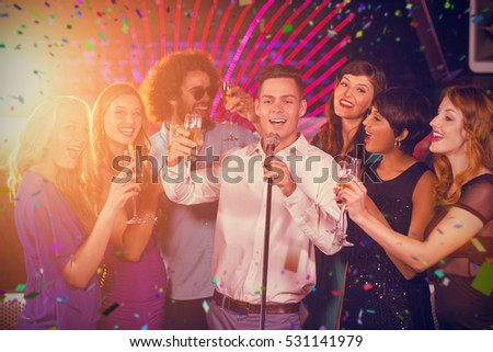 Group of friends singing song together in bar against flying colours