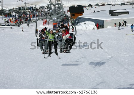 Group of friends sitting on a chairlift