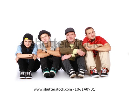 Group of friends sitting on white background - stock photo