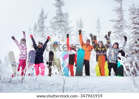 Group of friends skiers and snowboarders having fun on snowbound winter forest. Sheregesh resort, Siberia, Russia - stock photo