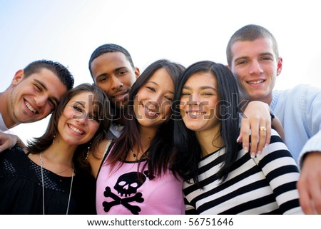 Group of friends smiling - stock photo
