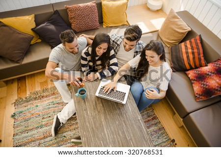 Group of friends study at the local coffee shop - stock photo