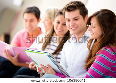 Group of friends studying together and smiling - stock photo