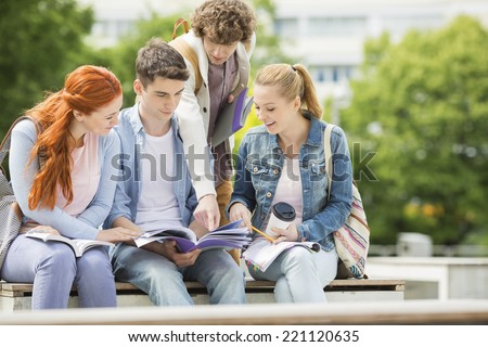 Group of friends studying together at university campus - stock photo