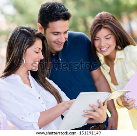 Group of friends studying together outdoors looking happy  - stock photo