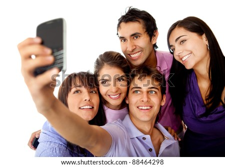 Group of friends taking a photo with their phone - stock photo