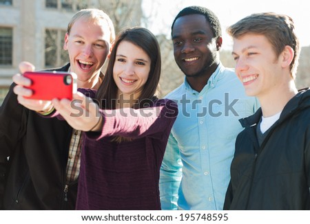 Group of Friends Taking a Selfie - stock photo