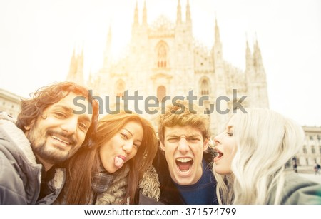 Group of friends taking funny selfies in Duomo square. Friends and fun concept - stock photo
