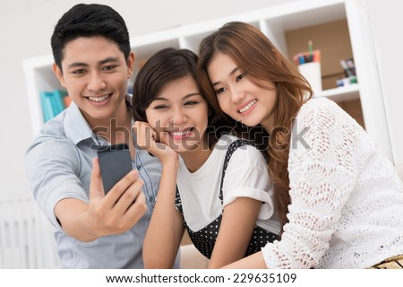 Group of friends taking selfie with a smartphone - stock photo