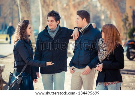Group of Friends Talking Outside - stock photo
