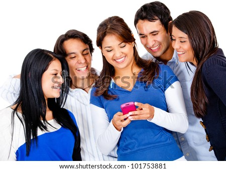Group of friends text messaging on their phones - stock photo