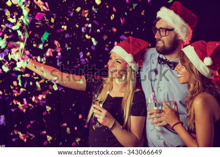 Group of friends, toasting and taking a selfie at New Year's Party - stock photo