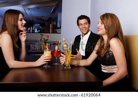 Group of friends together having fun. Focus on the man - stock photo