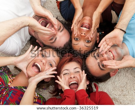 Group of friends together on the floor shouting