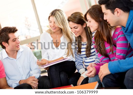 Group of friends together talking and having a good time - stock photo