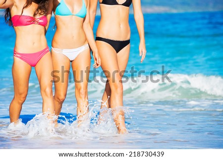 Group of Friends Walking on Tropical Beach.  Close up on Legs and Bikinis - stock photo