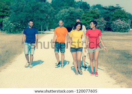 Group of Friends Walking Outside - stock photo