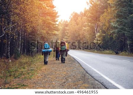 Group Friends Walking Backpacks Sunset Back Stock Photo 496461973 Shutterstock