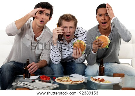 Group of friends watching a football game - stock photo