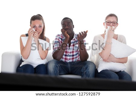Group Of Friends Watching Emotional Movie On White Background - stock photo