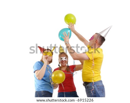 Group of friends wearing party masks and hats having fun over white