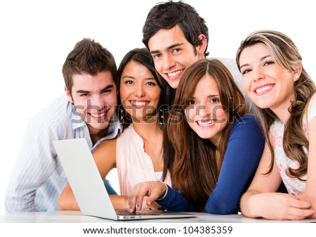 Group of friends with a laptop computer - isolated over white - stock photo