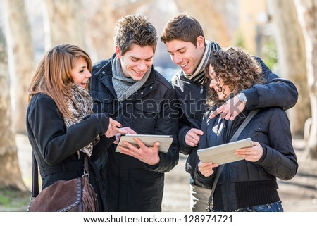 Group of Friends with Digital Tablet - stock photo