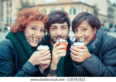Group of Friends with Hot Drink on Winter - stock photo