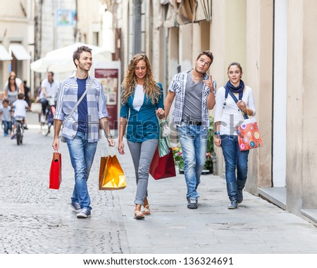 Group of Friends with Shopping Bags - stock photo