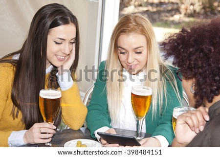 group of friends with the tablet