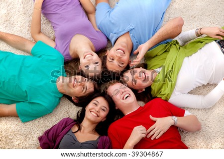 Group of friends with their heads together on the floor