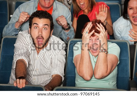 Group of frightened people in a theater - stock photo