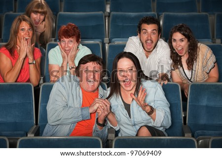 Group of frightened people screaming out in fear - stock photo