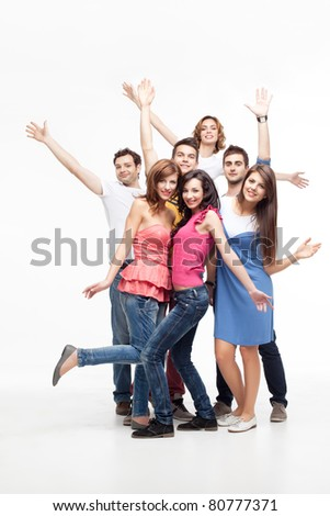 group of fun friends posing with hands in the air - stock photo