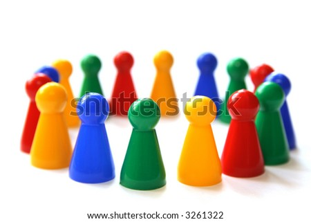 group of game figurines in a circle standing for the concepts unity, integration, diversity, cooperation
