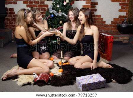 group of gilrs celebrated christmas clink and drink champagne - stock photo