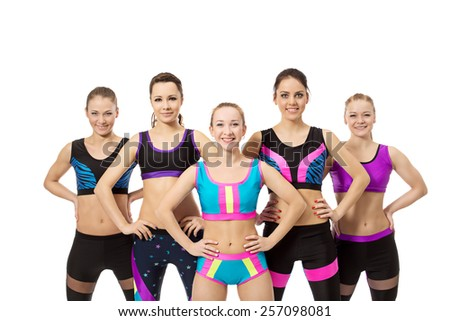 Group of girls for fitness smiling at camera - stock photo