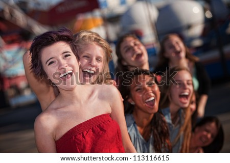Group of girls hanging out and laughing together - stock photo