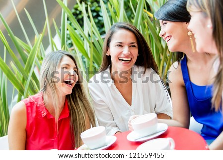 Group of girls having a coffee and talking - stock photo