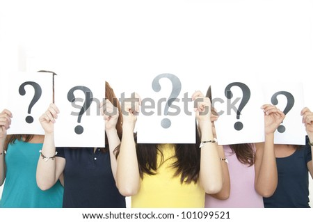 Group of girls holding question mark sign. - stock photo