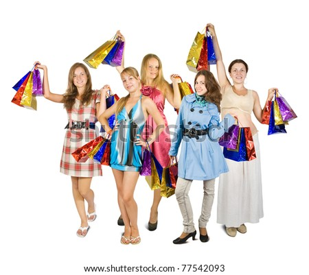 Group of girls holding shopping bags. Isolated in full length on white background - stock photo