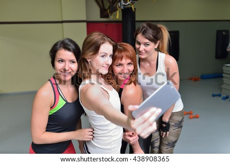 Group of girls in fitness class make selfie at smartphone
