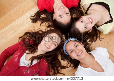 Group of girls lying on the floor with their heads together