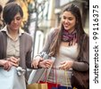group of girls make shopping with colored bags - stock photo