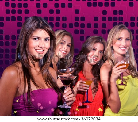 Group of girls on a night out having cocktails