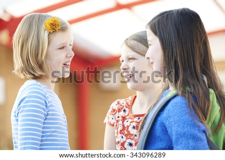 Group Of Girls Talking Outside School Building - stock photo