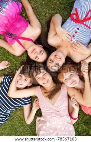 group of girls teenagers in park on grass - stock photo